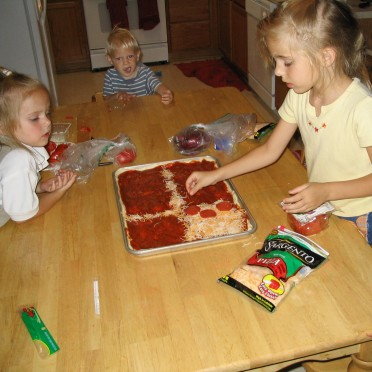01 - We would divide the pizza into sections using cheese