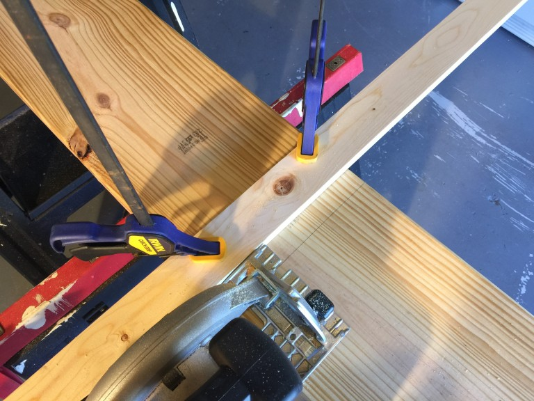 Use a guide clamped to the wood to ensure a straight cut