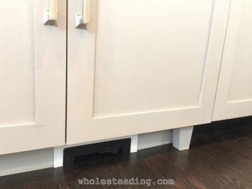 The automatic dustpan under the sink makes clean up easy