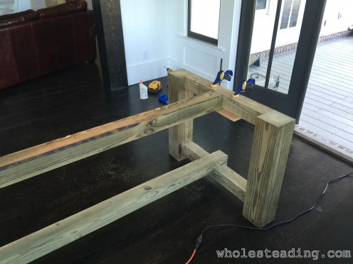 Finish connecting the top and bottom beams to the table ends
