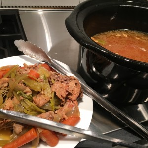 Making Chicken Stock: Remove Vegetables, Bones, and Skin Using Tongs
