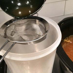 Making Chicken Stock: Strain Out the Solids